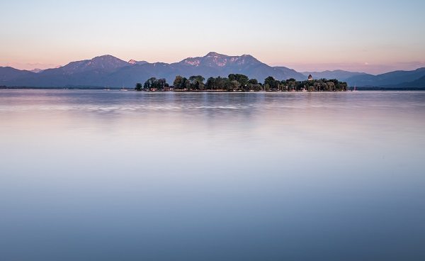 Lake Chiemsee and Fraueninsel at sunset in Bavaria  Germany 1133887439